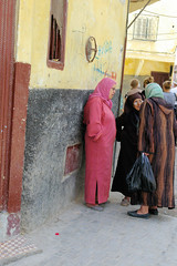 Tangier Ladies In Deep Discussion (cwgoodroe) Tags: ocean africa street old city sea summer people sun fish bus colors metal ferry plane children cafe sand ancient colorful doors artistic pentax vibrant muslim poor hijab streetlife mosque arabic panasonic doorway morocco arab friendly moors conservative script casbah vegtable merchants continent merchant christians tangier monger moroccan tanger kasbah cleric sadfaces metaldoors fishmerchant casba casbha dailylifeportrait
