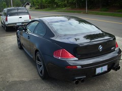 2009 BMW M6 (SoulRider.222) Tags: black reflection afternoon chrome bmw mspaint ps2 m6 michelin 250 v10 6series bmwm6 blackcar whileriding blackbmw 50l vanos michelintires 7speed pilotsport2 nikoncoolpixs50 michelinpilotsport2 40valves 50lv10 205mph 40valve michelinps2 2009bmw them6hasapowerbuttonthatmodifiesthethrottleresponsefromignitionthecardelivers399hpbutengagingthebuttonallowsafull500hp s85b50engine 50lv10507hp7750rpm384lbfttorque6100rpm 7speedsmgiiigearbox mahlemotorsport mahlemotorsportoilcooledforgedaluminumpistons vanostimingvalves doublevanostimingvalves carbonfiberreinforcedplasticroofpanel bmws85b50dohc40valvev10 s85b50 40valvev10 blackm6 blackbmwm6 michelinpilotsport2tires 2009bmwm6 2009m6