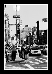 Wait for walk (Simone Bonazzoli) Tags: china street new york nyc light people bw usa white ny black film analog america canon eos for town us chinatown traffic 33 walk united broadway bn scan semaforo wait hp5 states bianco ilford nero analogica attesa standin pellicola blackwhitephotos