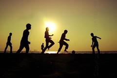 Free Kick (diankarl (www.diankarlina.com)) Tags: city travel sunset sea sky people urban playing black beach boys silhouette playground kids indonesia landscape java football asia southeastasia dusk soccer jakarta ancol pantai northjakarta jakartautara diankarl diankarlina wwwdiankarlinacom