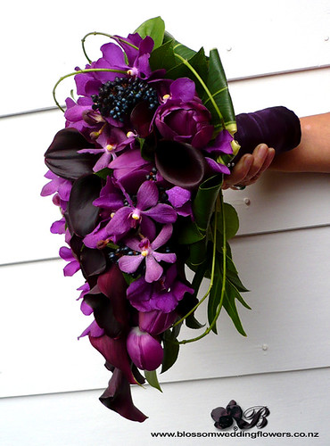purple bridal bouquet with callas tulips orchids berries and vines