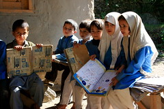 Education Starters (Kutan - Kashmir, Pakistan) (Amir Mukhtar Mughal | www.amirmukhtar.com) Tags: blue school pakistan light people cute beautiful bench children book education uniform dress faces little innocent hijab books amir learning kashmir studying cutes mughal kutan mughals amirmukhtar kamicalander