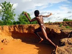 joy of jumping (ico_nico) Tags: africa boy naked jumping joy bathing burkinafaso actionshot
