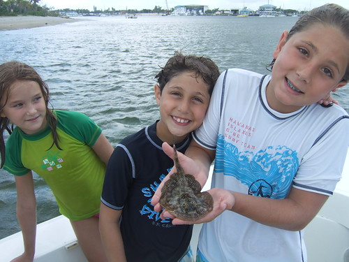 Robert, Jonathan and Rylee with a barbless yellow ray!