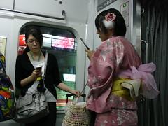 call me, maybe it's late, but just call me (Samm Bennett) Tags: woman mobile japan train tokyo phone cellphone rail jr keitai kimono