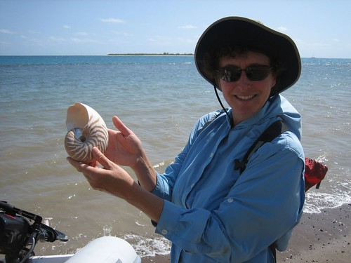 Laura with nautilus shell, Ile Hugon