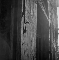 old wooden door, hardware, entranceway, Via Guelfa, Cortona, Tuscany, Italy, Rolleicord, Fomapan 200, Moersch Eco Film Developer, early November 2016_ (steve aimone) Tags: wooden door doorway entrance hardware intothesun backlit viaguelfa cortona tuscany italy rolleicord fomapan200 moerschecofilmdeveloper 120 120film film mediumformat monochrome monochromatic blackandwhite architecture storefront