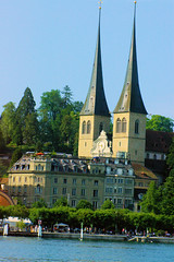 Lucern Church (cwgoodroe) Tags: sun mountain lake snow alps green church statue ferry fairytale swimming switzerland boat europe locals suisse swiss sunny location farms movieset luce swissalps lucern medivil beerpasture