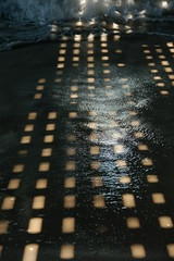 Light on Water (DeepFriedBacon) Tags: ocean shadow water lights pier newjersey waves shore boardwalk seasideheights dadseaside09