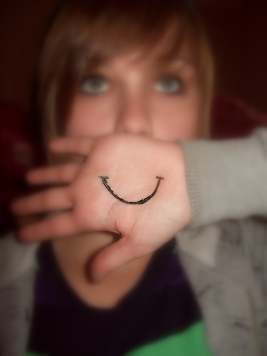 the way to be happy: paste on a smile?