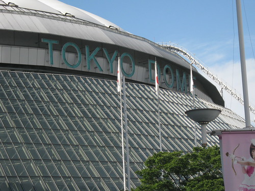 The Tokyo Dome exterior with the roller coaster partially visible.