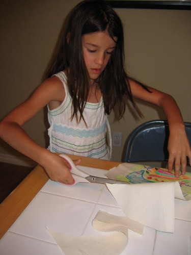 Mermaid cutting out her dolphin pillow design