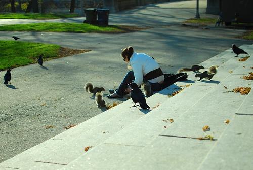 lady feeding squirrels