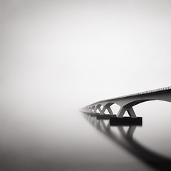 Vanishing I (Joel Tjintjelaar) Tags: bridge square vanishing bwphotography michaelkenna zeelandbrug thefog daytimelongexposure zeelandbridge nd110 bratanesque silverefexpro tjintjelaar bwnd110filter huggingandkissingabridge somepeoplepassingbytheymusthavethoughtilostmymindhuggingthisgiganticstructure extremedayti