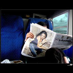 Reading... (Osvaldo_Zoom) Tags: sea italy train reading newspaper reader commuter calabria berlusconi vattene canong7