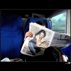 Reading... (Osvaldo_Zoom) Tags: sea italy train reading newspaper reader commuter calabria berlusconi vattene canong7