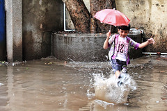 Such innocence and such freedom! (Amol Makode) Tags: india chicago beautiful rain canon photography 50mm interesting eyes bokeh indian m monsoon 1855mm f18 waterdrops pune amol 550d 55250 makode 55250mm amolmakode