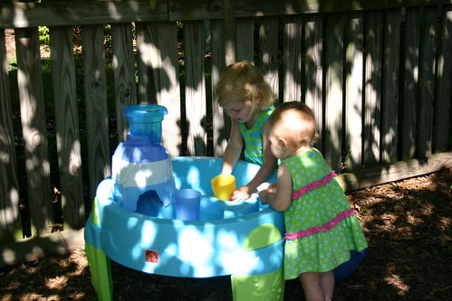Girls playing with their water table
