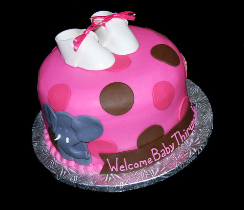 pink and brown jungle themed baby shower cake with elephant and lion