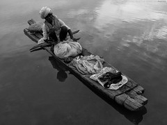Let the River Flow (Kausthub) Tags: portrait people bw india net water boat blackwhite fisherman 2009 boatman g10 grouptripod canonpowershotg10 powershotg10