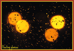 115. Raindrops and streetlights (fleetingglances) Tags: street raindrops lamplights
