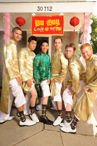 Groomsmen in chocolate argyle socks underneath traditional ao dai