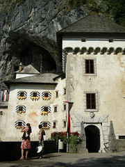 Predjamski grad (Helen Boronia McHugh) Tags: door flowers roof chimney castle yellow rock french dress flag slovenia shutters cave grad platforms 5photosaday predjamski