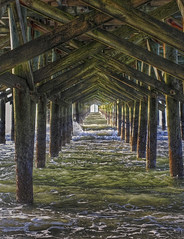 Under the Pier (konrad_photography) Tags: beach sc pier surf waves south carolina myrtle hdr surfside
