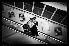 _N8_L1000374bw copy (mingthein) Tags: leica travel bridge england blackandwhite bw woman man motion blur london love public monochrome station zeiss train underground kiss couple action availablelight escalator transport tube m traveller commute passion m8 commuter ming biogon zm onn 2128 thein photohorologer