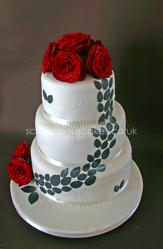 Wedding Cake Fresh Red Roses and Black Leaves