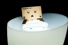 Mesmerized (MSG Mike) Tags: life light macro lamp up bulb pose lens toy 50mm prime robot eyes nikon focus glow looking action box watching sigma shade flourescent figure electricity stare glowing lit manual staring f28 compact cfl mesmerized danbo poseable d90 danboard