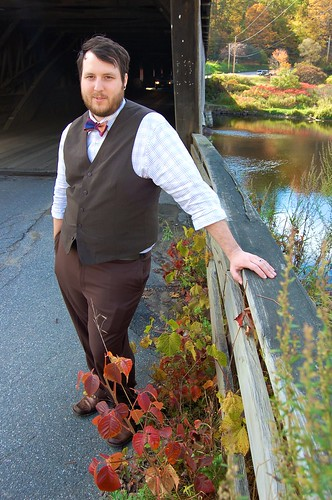 groom portrait on covered bridge