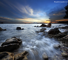Flow Over My Soft Sweet Cassandra ;-) (Ragstatic) Tags: ocean travel sunset sea people holiday seascape tourism water rock relax photo google search nikon singapore asia waves rags culture visit photograph destination singaporebeach uniquelysingapore d700