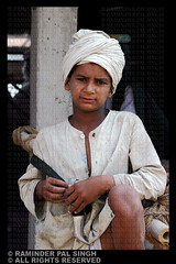 Sikh Kid (Raminder Pal Singh) Tags: portrait india nikon devotion sword resting turban punjab amritsar takingabreak goldentemple afc headgear attire kirpan digitalportrait parna harimandirsahib kidportrait darbarsahib kidsmiling curiouslook sachkhand harimandarsahib voluntaryservice raminderpalsingh sikhsymbol karsewa sikhkid memorycornerportraits sikhkidsitting kidtakingabreak harimandarsahab shotonnikon kidwithheadgear sikhkidwithturban turbanpride lookingcuriously kidlookingcuriously kakkaar