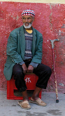 Blind Man in Morocco II (cwgoodroe) Tags: ocean africa street old city sea summer people sun fish bus colors metal ferry plane children cafe sand ancient colorful doors artistic pentax vibrant muslim poor streetlife mosque arabic panasonic doorway morocco arab friendly moors conservative script casbah vegtable merchants continent merchant christians tangier monger moroccan tanger kasbah cleric sadfaces metaldoors fishmerchant casba casbha dailylifeportrait