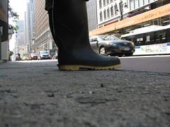 Boots in the City (ohwhatachristy) Tags: nyc newyorkcity urban june pavement manhattan 34thstreet midtown sidewalk groundlevel wellies 2009 waitingforthebus birthdayweekend timershot