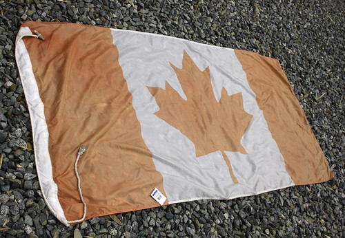 Faded vintage Canadian flag with Value Village tag, $3.99