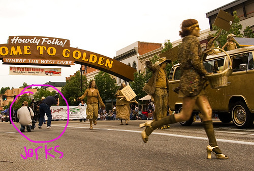 A lovely golden dance troupe is marred by photographers who put themselves in the way for the entirety of the parade.