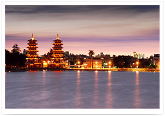 2833     -             - Sunset Moment On Dragon and Tiger Pagodas . Zuoying Lotus-Pond Scenic Area .Landscape of Kaohsiung City - TEMPLE CULTURE OF TAIWAN (deepblue68) Tags: world life city light sunset shadow sky sunlight lake color reflection building tower art nature water architecture night clouds sunrise buildings landscape outdoors photography scenery tour natural image explorer taiwan environmental explore vision kaohsiung environment lighttrails moment formosa   2009    pagodas cityview archi lightstreams        lotuspond        zuoying         apathwayhomecom deepblue68
