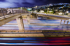 At the Speed of Light (Ryan Eng) Tags: city blue red cars concrete lights hawaii highway traffic oahu overpass explore walkway freeway honolulu streaks frontpage dri blending longexposures hardingave waialaeave bluemovement ryaneng viewingthisphotomeansyouregettinga2fer andyesyoushouldfeelspecial