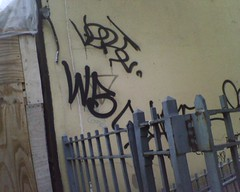 (who it iz) Tags: nyc graffiti wb vert
