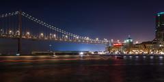 Wavelength (Nocturnal Bob) Tags: sf sanfrancisco california longexposure bridge night boats lights bay baybridge embarcadero cupidsspan rinconpark pier14 hillsbroscoffee