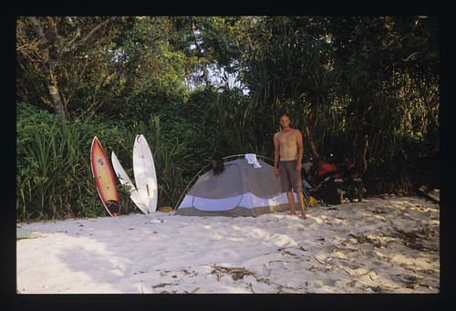 Ed camping out in Indonesia with his FCD Octo surfboard at the ready