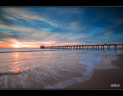 Motion at Henley Jetty (Dale Allman) Tags: ocean sunset motion water clouds canon sand waves jetty australia wideangle explore adelaide southaustralia lightpole 1740 henleybeach henleybeachjetty canon5dmkii 5dmkii saariysqualitypictures