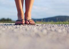 On a long evening walk towards sunshine~ (Tja'Sha) Tags: flipflops summerevening rednails nikond40 fiddywhores hbweve lightinmylife dofalicious littlebokehs longeveningwalk ontheoffroad lovethemhavaianas