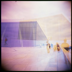 Oslo Explosion (Eric Nye the Science Guy) Tags: travel vacation colors beautiful oslo norway architecture modern triangles norge holga lomography doubleexposure 120film velvia100 inspiring colorexplosion surrealreality holgacfn colorfilters belugawhales sharpangles oslooperahouse peopleasplacesplacesaspeople