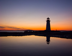 Peggy's Cove sunset (DGMiller777) Tags: ocean sunset sky lighthouse canada reflection water silhouette bronze night bay aperture rocks raw novascotia dusk ns atlantic explore international awards peggyscove 2009 stmargarets dng chdk flickrhivemind