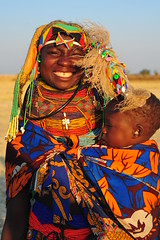 mother and son (luca.gargano) Tags: africa sunset colour market mother feather son ostrich huila angola gargano lucagargano mumuhuila mumuhuilas