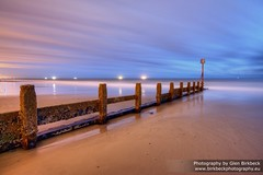True Colours (~Glen B~) Tags: longexposure blue sea sky orange beach yellow misty night coast wooden sand colours ships horizon shore redcar groynes shamelessreferencetocindilaupersong missilecommandexplosionsonthehorizon redbubble:id=39376282truecolours