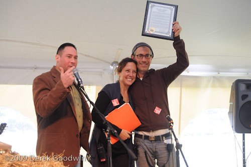 Woodstock founders Jenny Brown and Doug abel receive an award from Ulster County Legislator Brian Shapiro